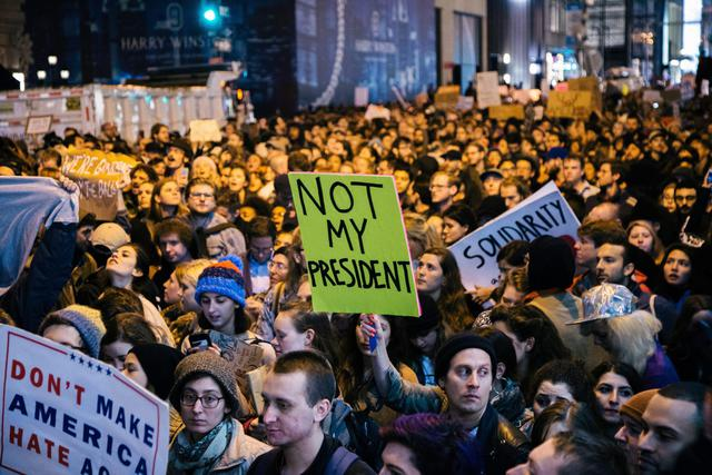epa05624834 People participate in a protest against the election of Donald Trump as President of the United States in New York, New York, USA, 09 November 2016. President-elect Donald Trump will become the 45th President of the United States of America to serve from 2017.  EPA/ALBA VIGARAY